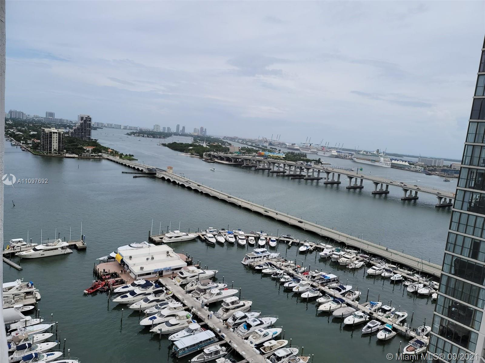 Beautifully remodeled unit at The Grand with stunning views of Biscayne Bay and Miami. Unit complete
