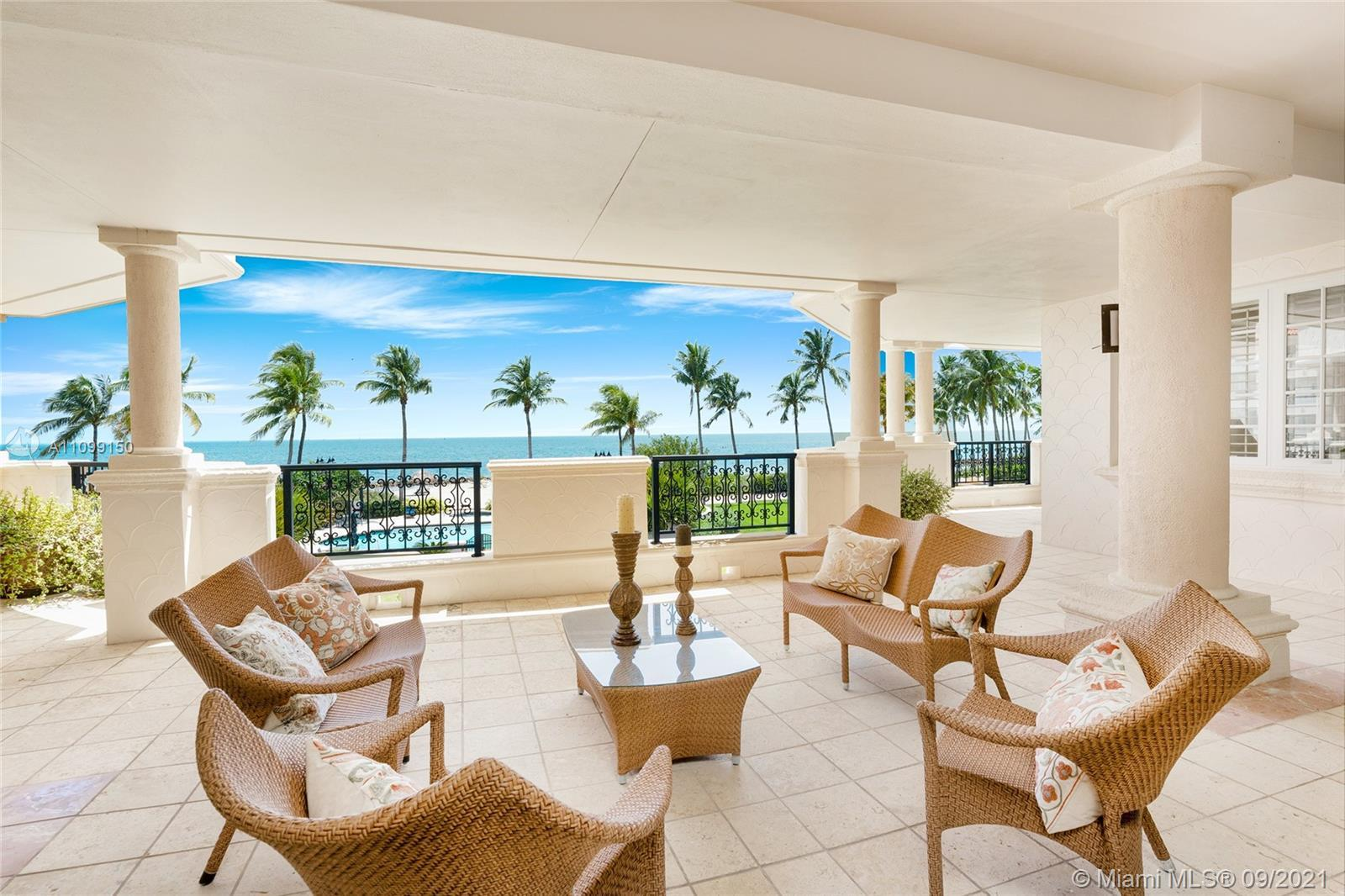 This 2nd floor Oceanside center-stack unit boasts an expansive wraparound terrace w/comfortable seat