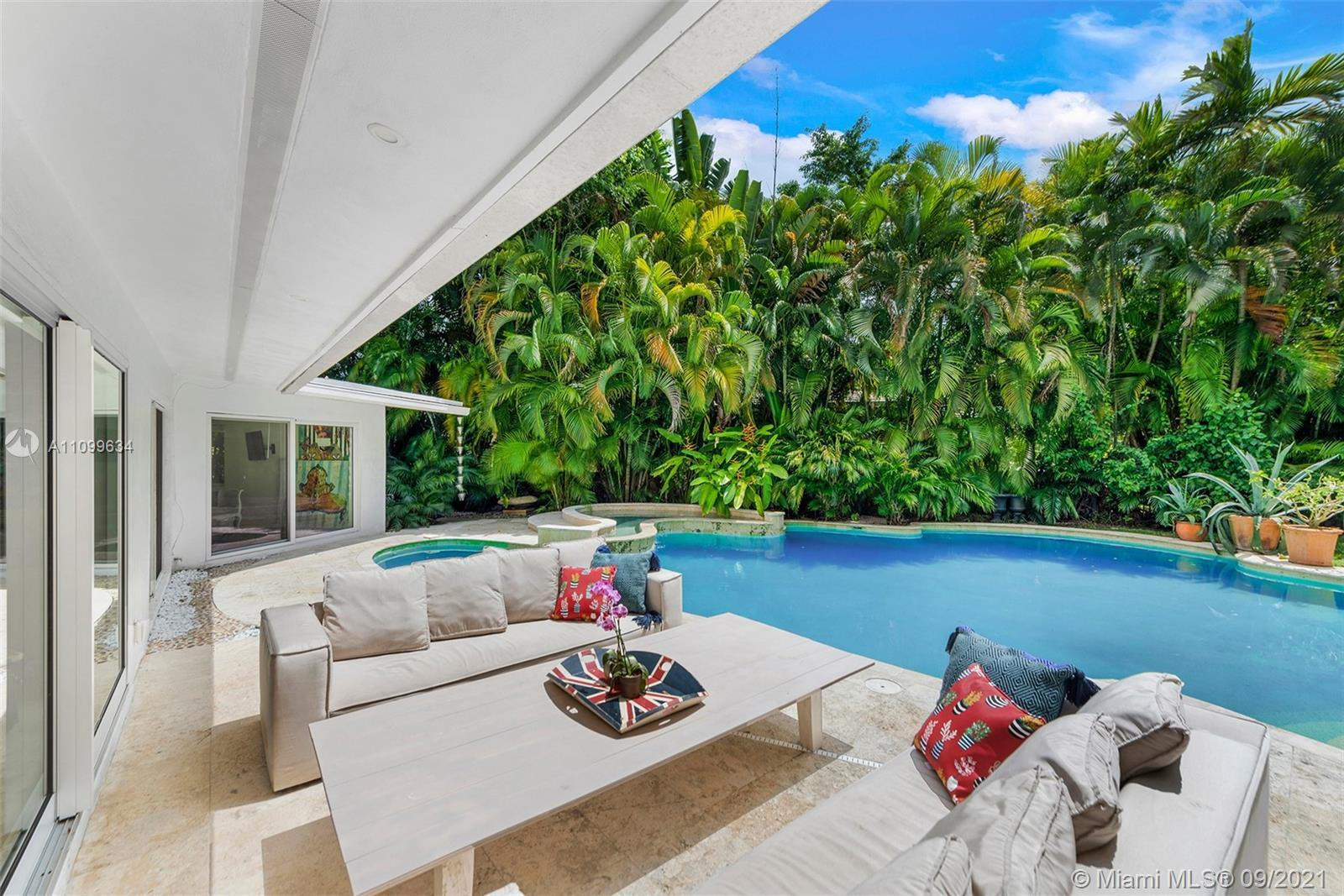 Once in lifetime Miami Shores opportunity to live in a private, tropical oasis under majestic oaks o