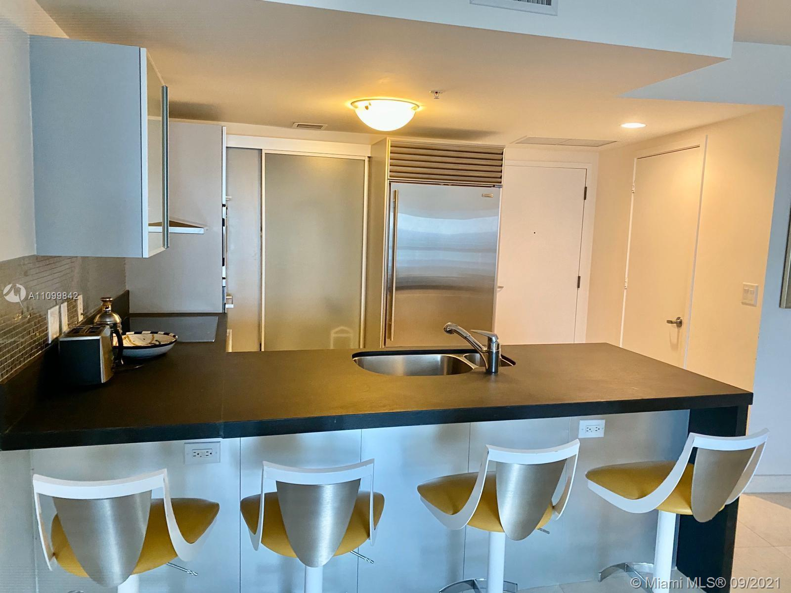 BEAUTIFUL FULLY FURNISHED PENTHOUSE UNIT. MARBLE FLOORS THROUGHOUT, OCEAN AND CITY VIEWS. LIVING ARE