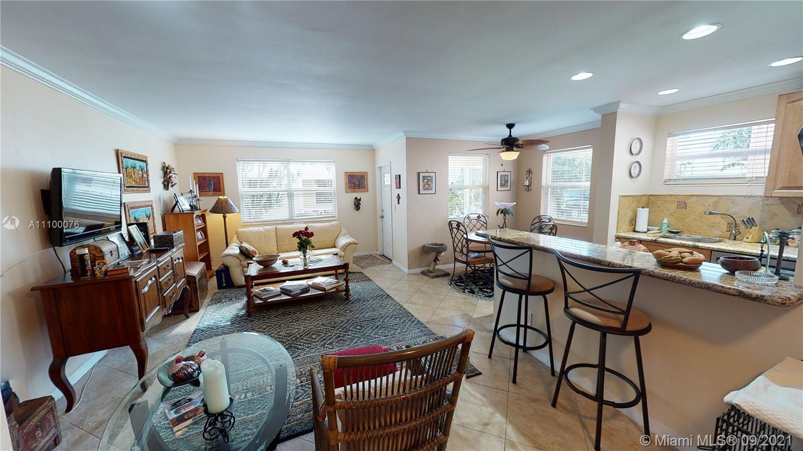 Stunning updated 2/2 on the water! Impact windows and doors. Community with boat dock, ocean access,