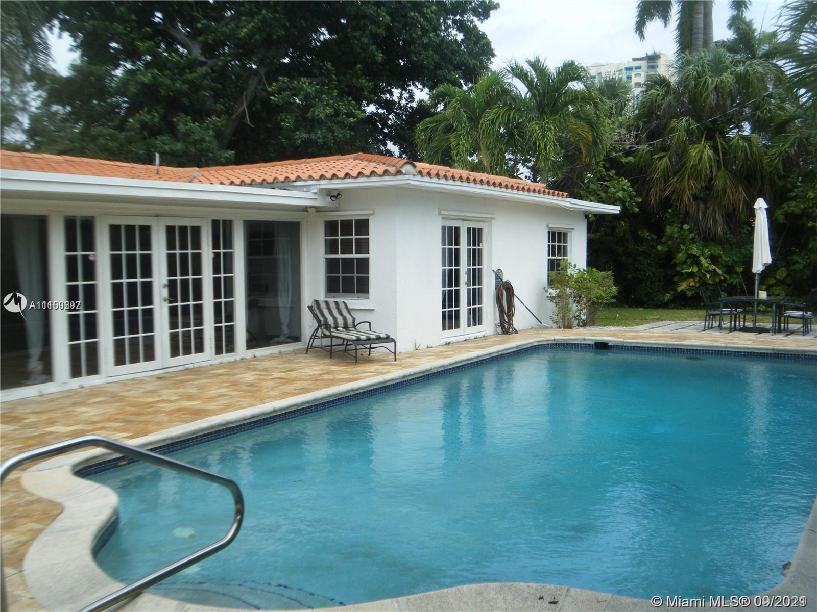 Updated 4 bedroom,4 bath (2 master suites) and double split plan ,swimming pool, 2 car garage in one