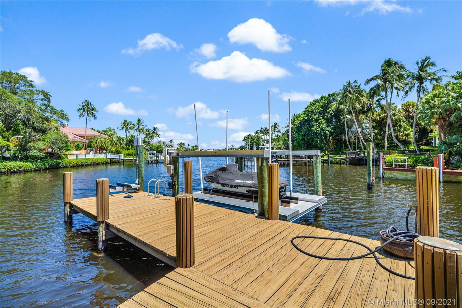 Expanded Courtyard Home with long water views. The home is lushly landscaped for privacy. Enjoy your