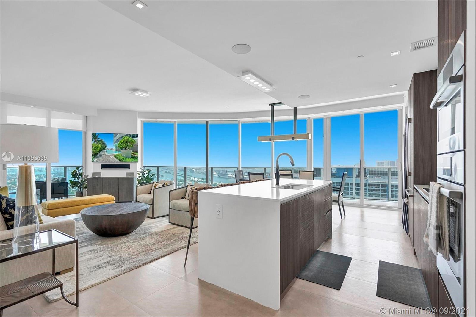 Aria on the bay brings you this STUNNING Fully Furnished/Turn Key beauty in the sky. Remarkably deco