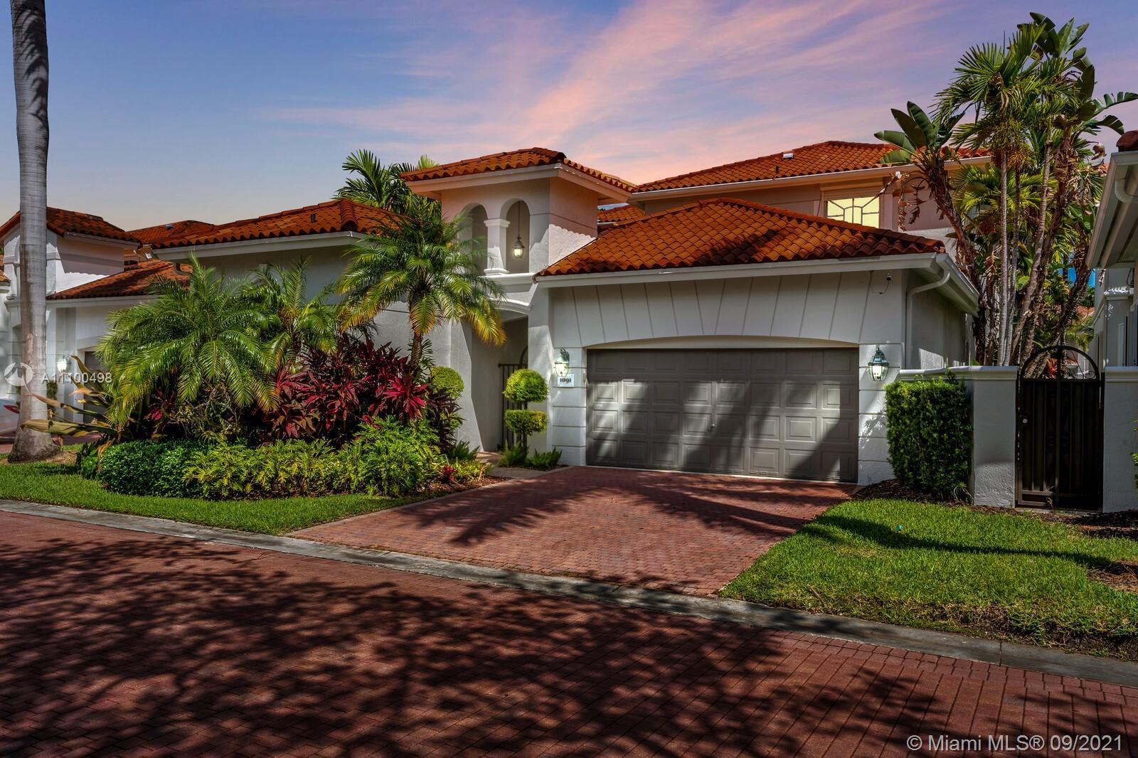 Located in the prestigious gated community of Harbor Islands, this beautiful property features 3 bed