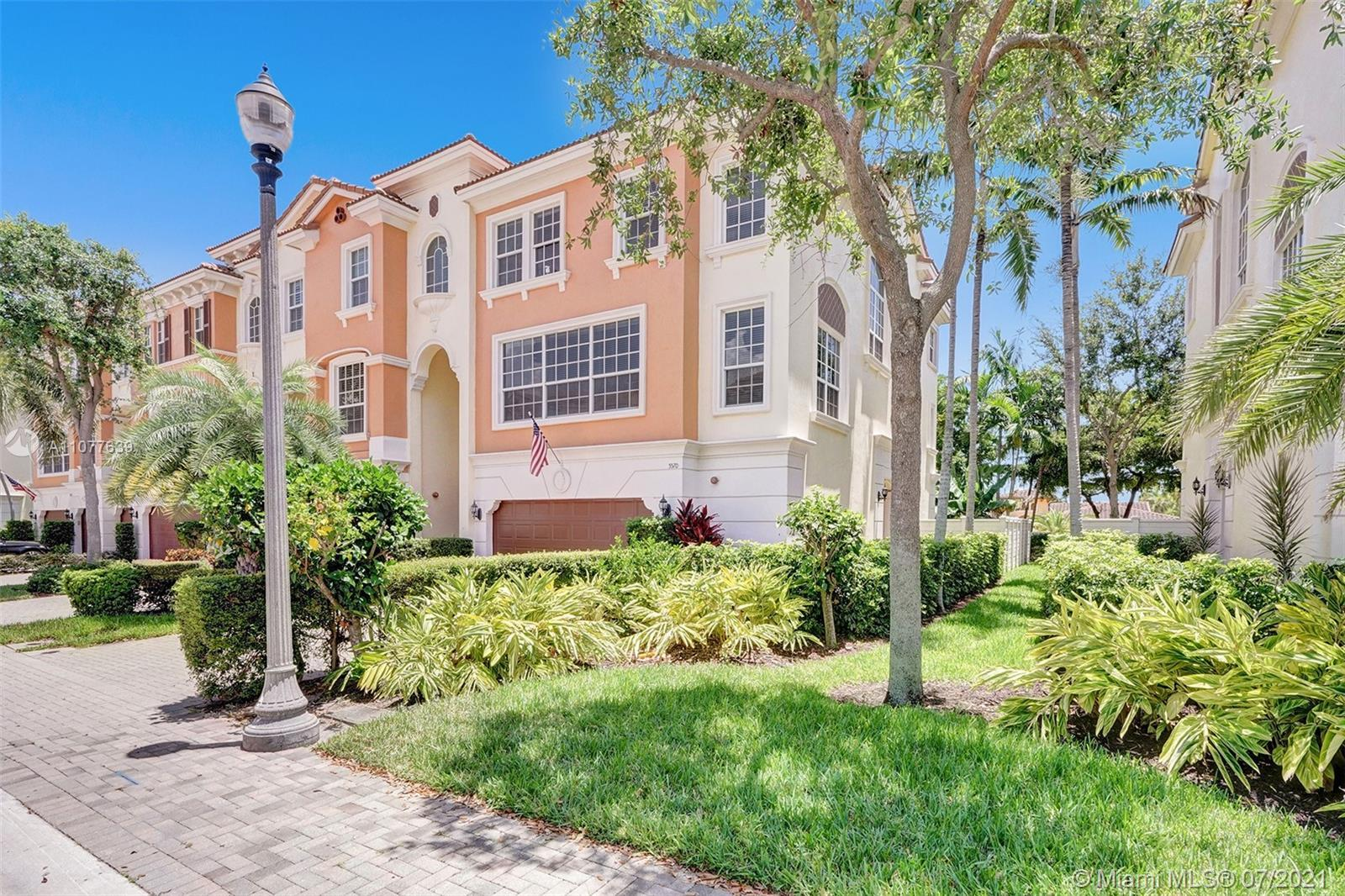 BACK ON MARKET Luxurious tri-level 4 BR/3.5 BA end unit townhouse in East Boca with smart locks & th