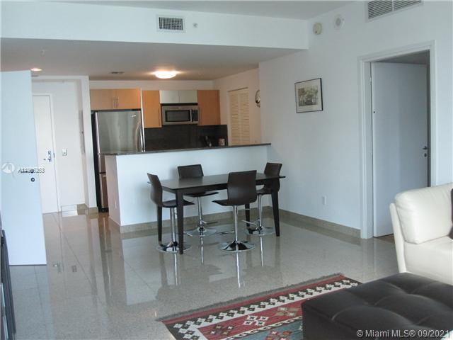 Lowest priced 2/2 condo with side views of River and Bay. Split plan. Exquisite granite floors in li