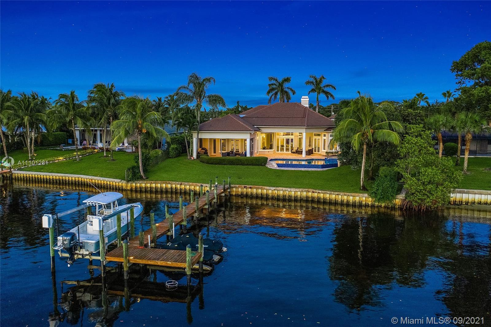 River living at its best! This home is located on the widest part of the Loxahatchee River in the de
