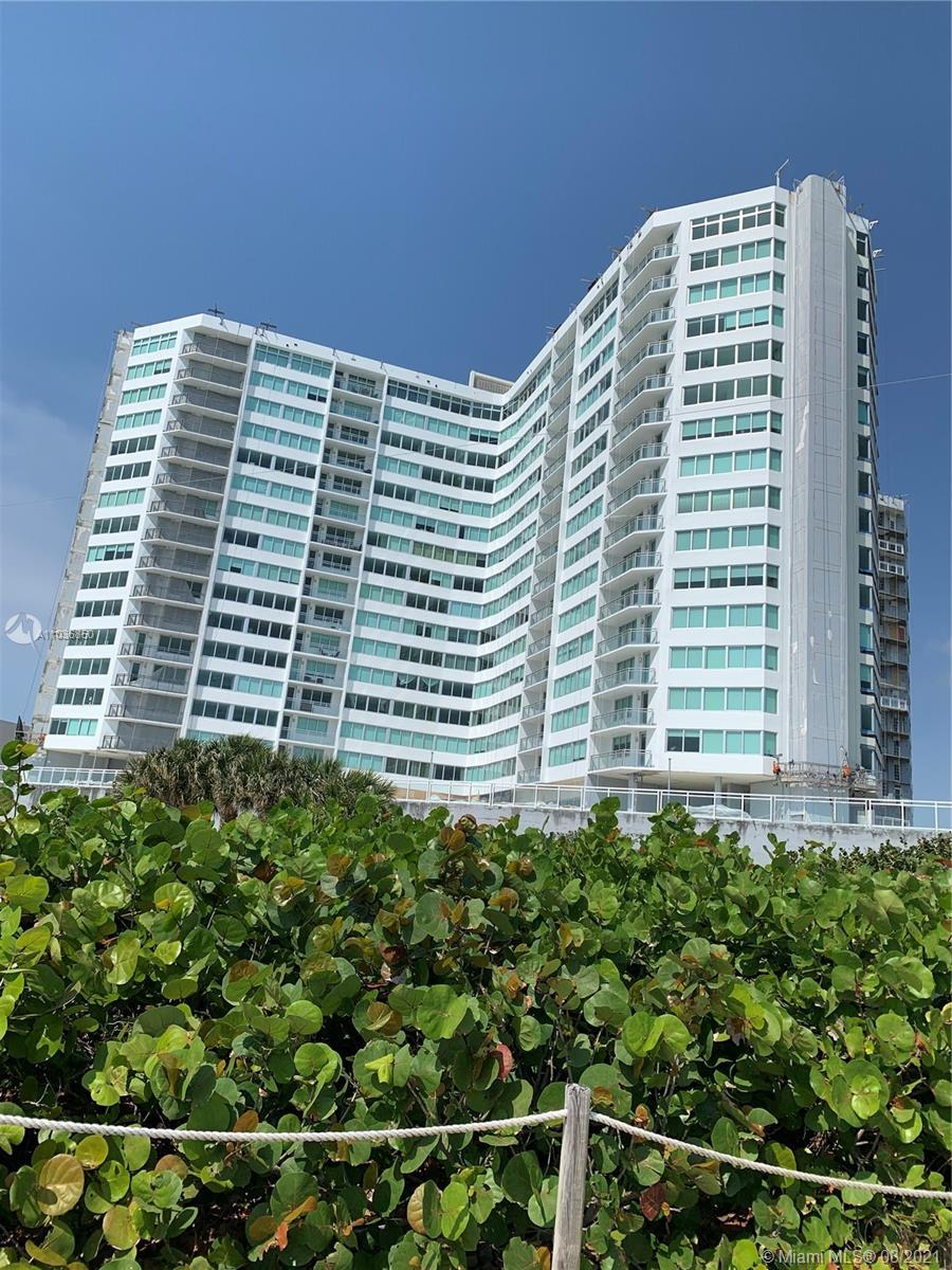 Dynamic ocean views located on the north side of the building with a balcony. New impact windows is