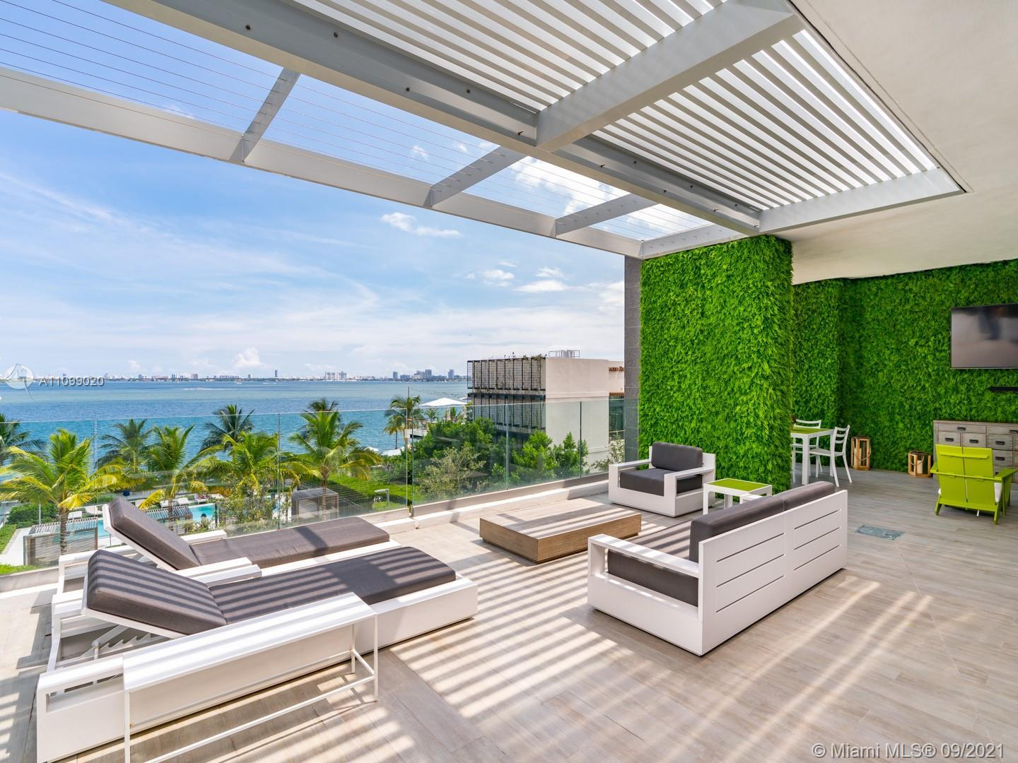 Stunning Ultra-Contemporary Bay Home Townhouse combining single-family living with resort style amen