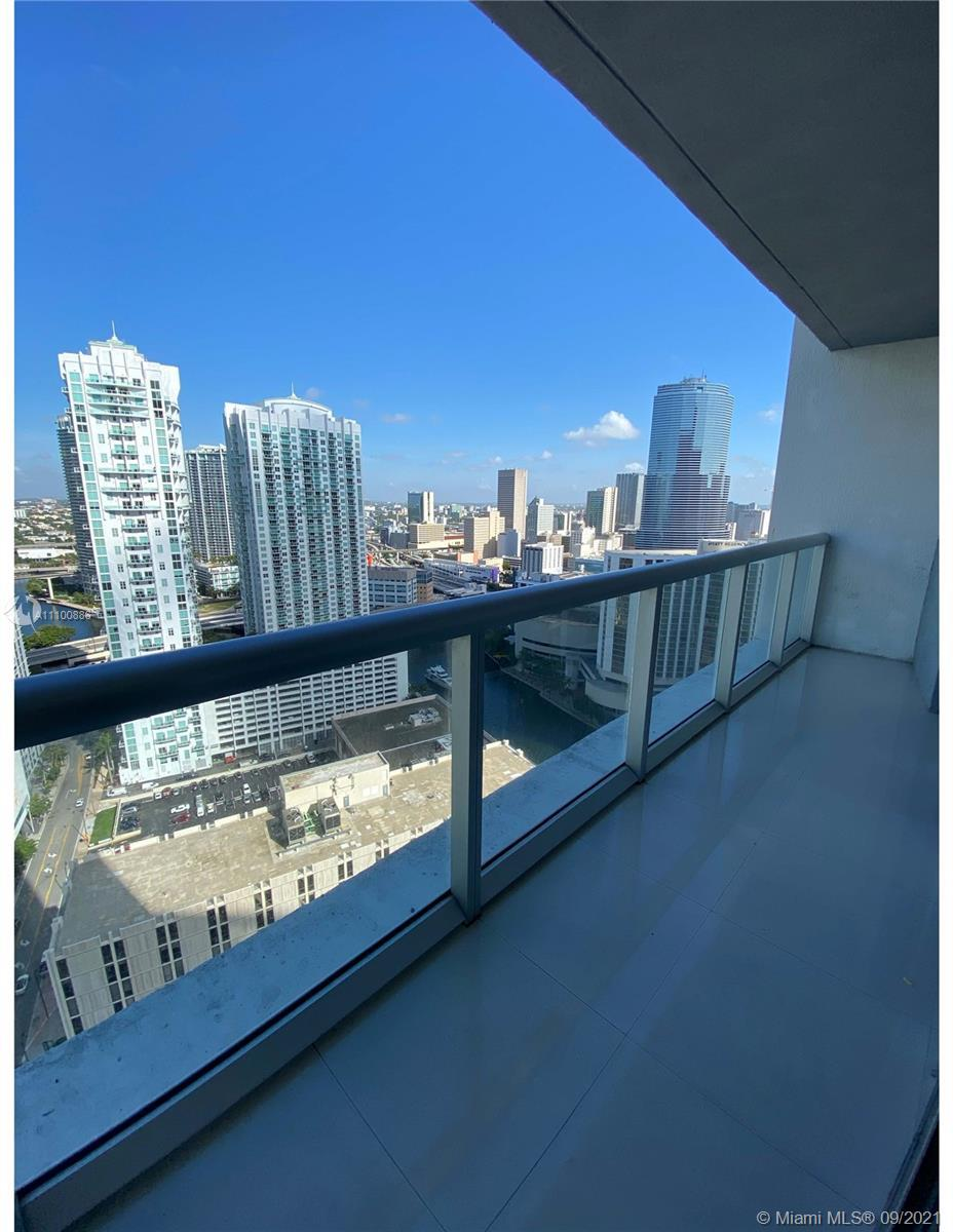 Beautiful 1 bed/1 bath unit in luxury high rise building with stunning views of the city, river, and