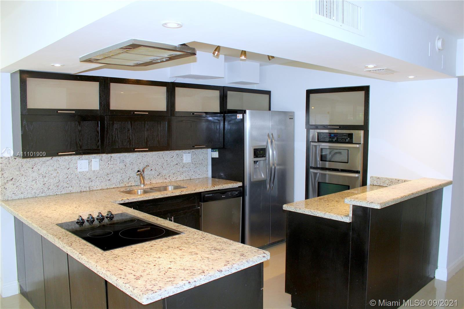 Amazing Opportunity to Buy a 4 Bedroom 2.5 Bath Townhouse/Condo in the heart of Aventura. Unit featu