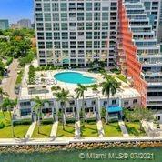 Remarkable & Renovated Flow through corner unit offering incredible water and city Skyline views fro