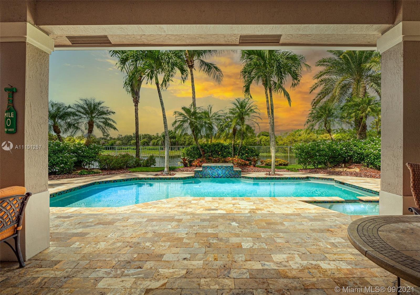 Stunning 2-story lakefront home in the exclusive Weston Hills CC - Hunter's Pointe! Impeccably maint
