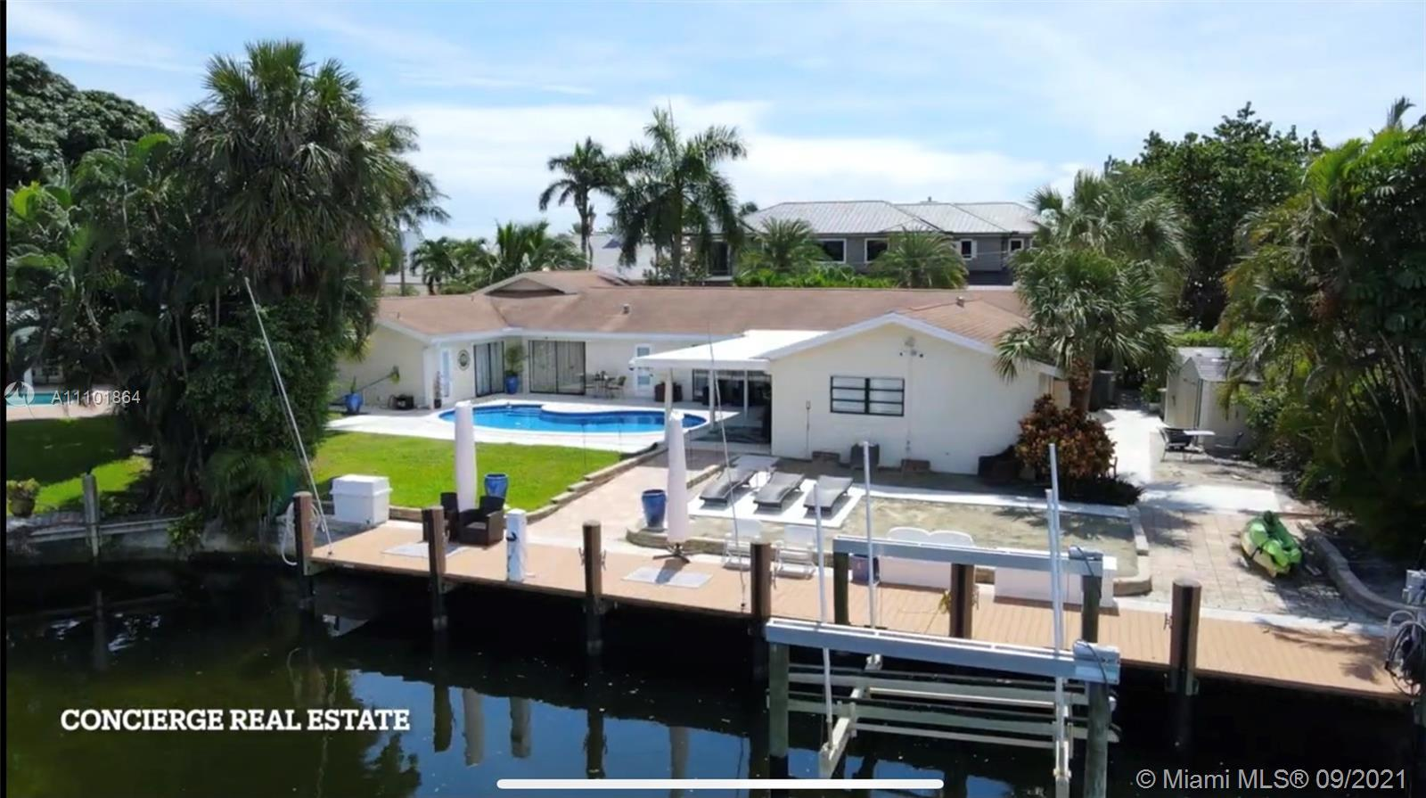 Location @ Its best Boat Lovers in LAKE PLACID @ LIGHTHOUSE POINT. This 5BR/4B home is located on a