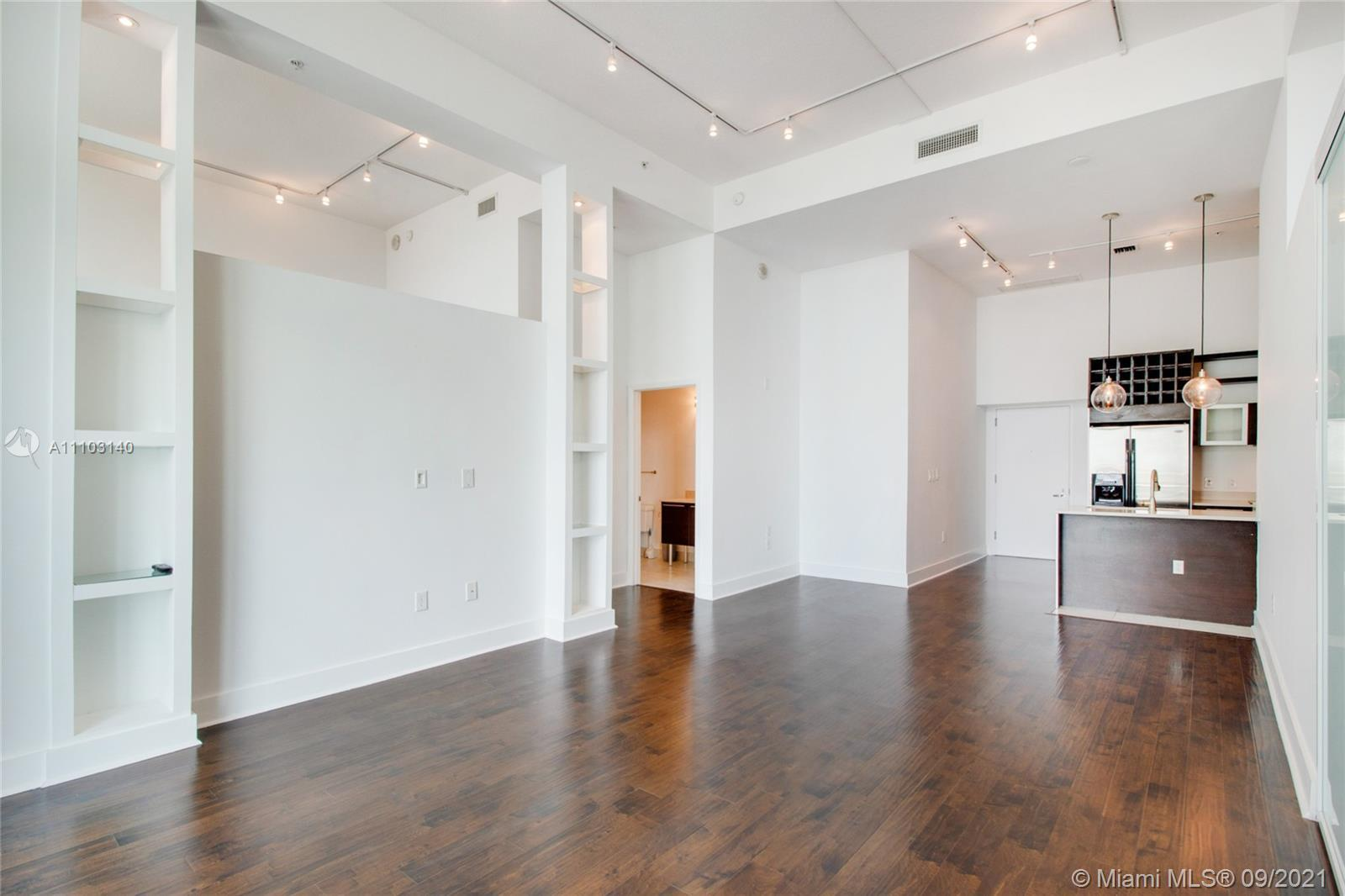 Spacious and beautiful 2 bed/2 bath loft style unit with extra-high 13 ft ceilings in one of the mos