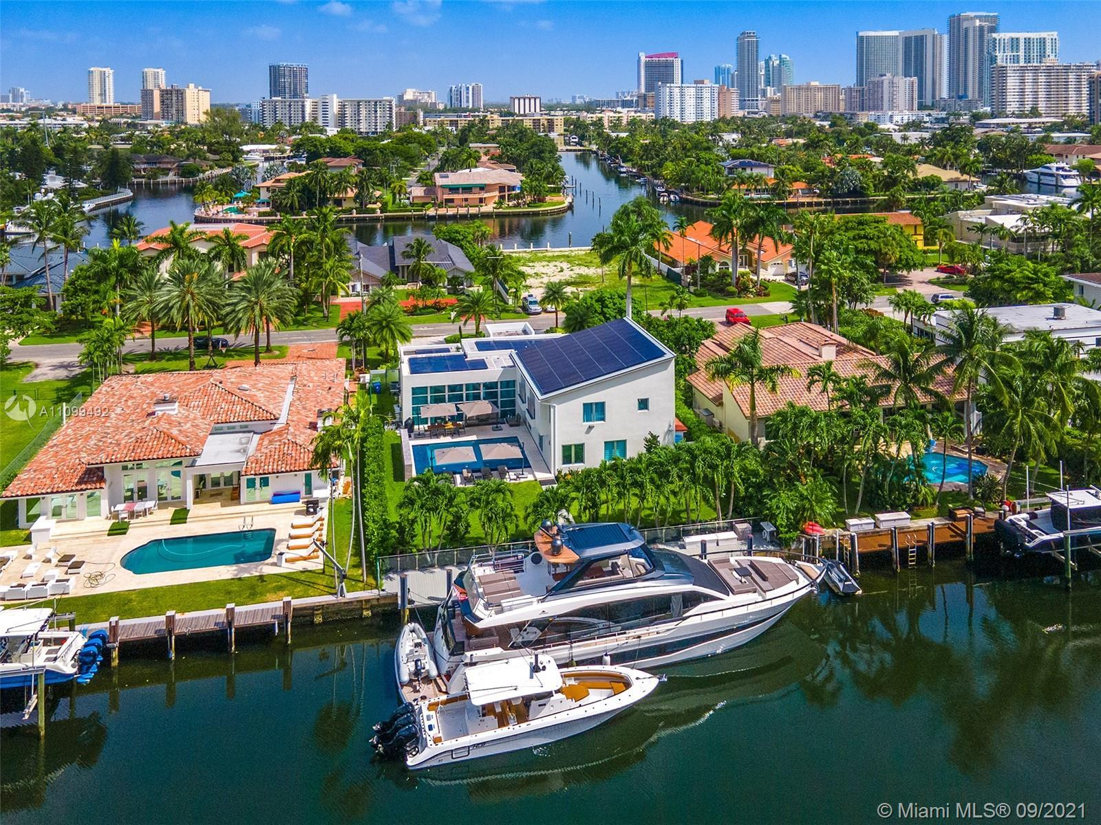 Contemporary Waterfront Estate in sought after gated Golden Isles community, one of South Florida's