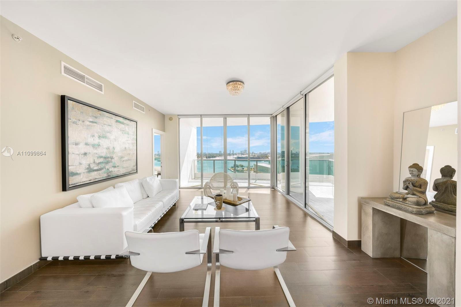 A beautiful and bright 2 Bedroom + Den/3.5 Bath flow-through corner unit at 900 Biscayne Bay with 1,