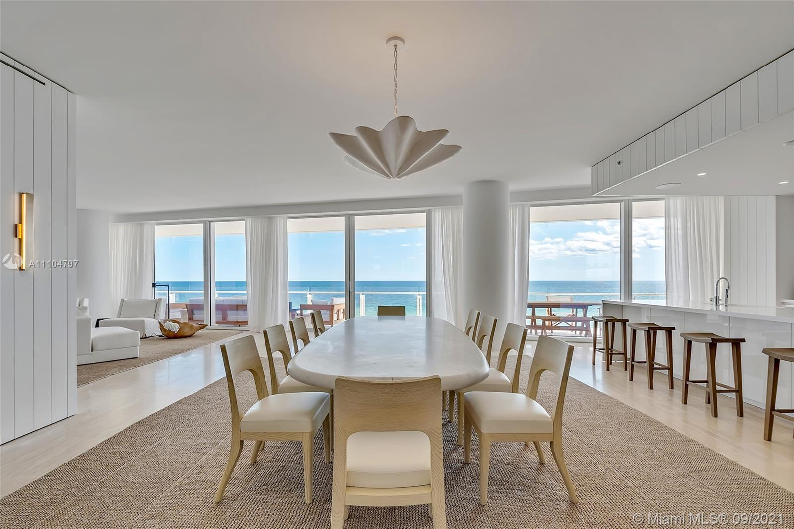 One-of-a-kind oceanfront corner residence in the Four Seasons @ The Surf Club. Classic & contemporar