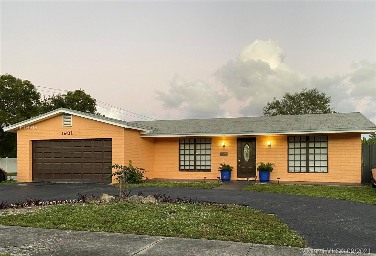 Lovingly maintained and meticulously updated 4BD/2BA corner home in the highly desirable Hollywood H