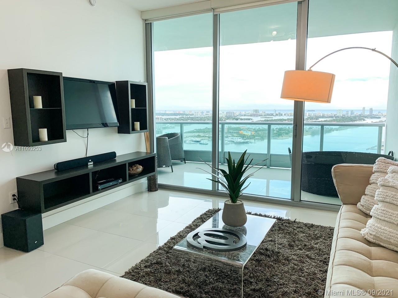 Stunning 180 degree views of Biscayne Bay, Atlantic Ocean & Miami Skyline.This is 1 Bedroom plus Den