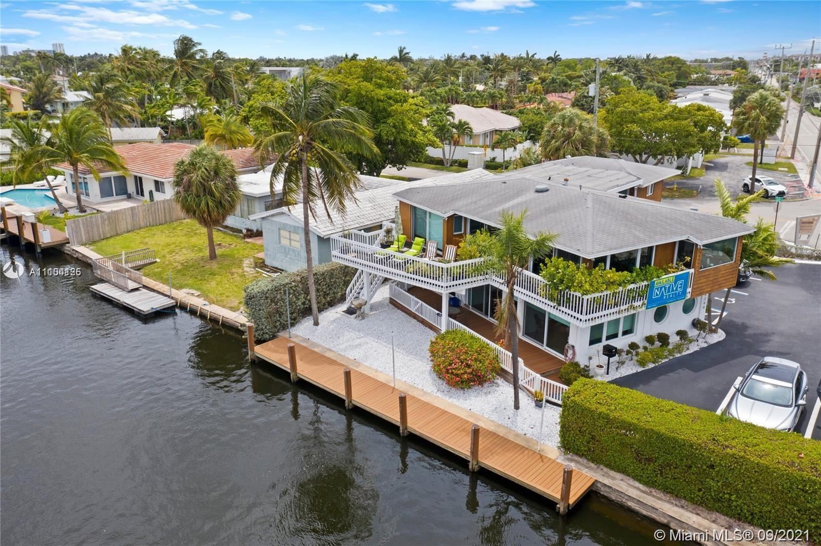 Native Realty is proud to present this turnkey WATERFRONT LIVE/WORK HOME one block from Federal Hwy.