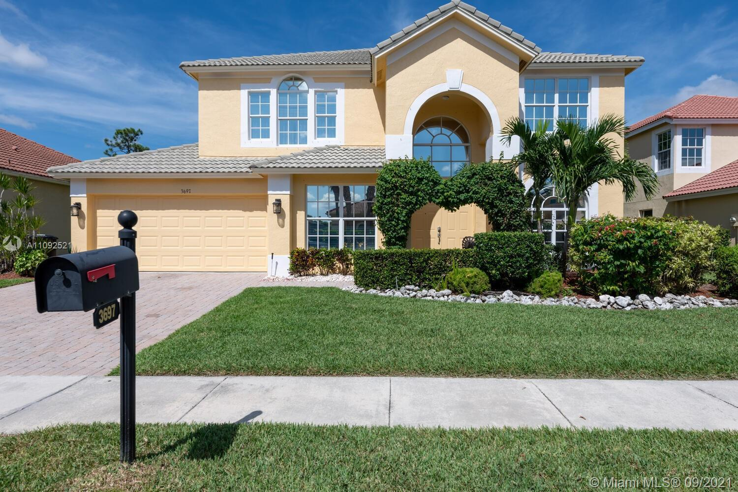 Located in Hamilton Bay, you'll want to make this spacious two-story 5BR/3BA/2-car garage plus a lof
