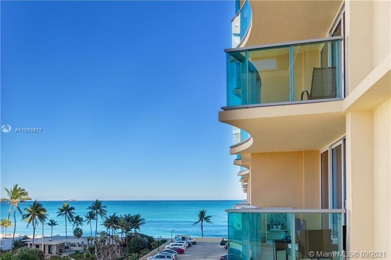 Enjoy resort style luxury living in this beach front, ocean view condo. This 2-bedroom corner unit h