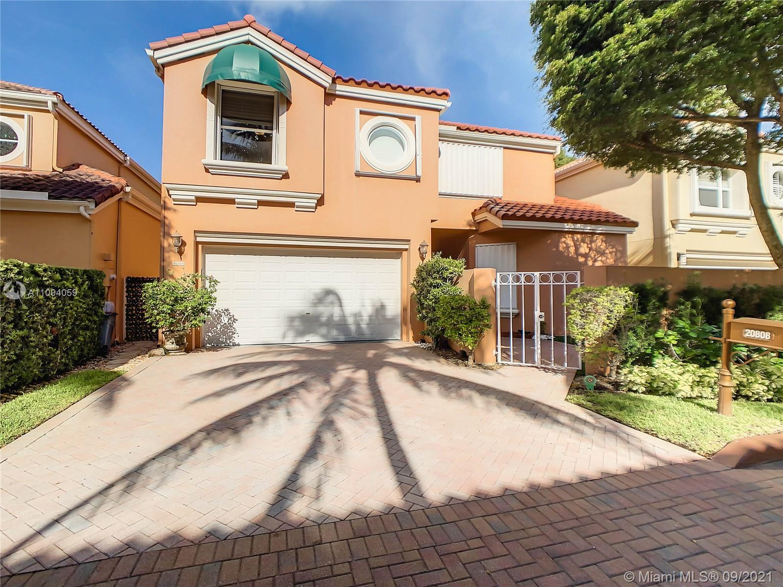 In the heart of Aventura, great opportunity to own this exquisite 2 story single family home in the