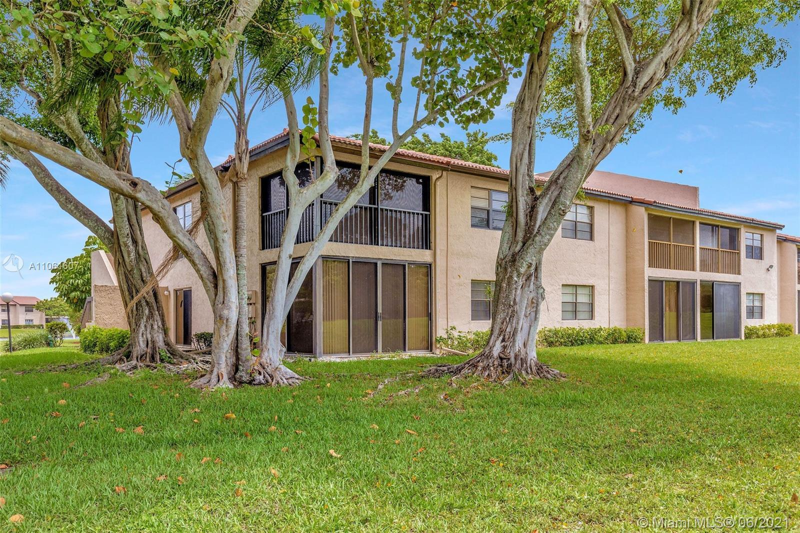 OPEN AND BRIGHT 1ST FLOOR CORNER UNIT IN THE DESIRED 55+ PINES OF BOCA LAGO, 2 BEDS, 2 BATHS WITH PL