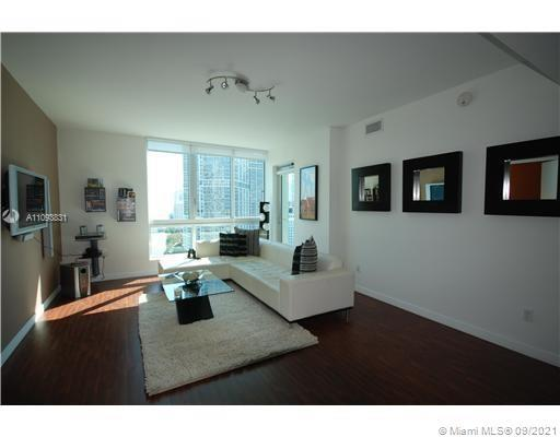 Fabulous, 2BD/2BTH one-of-a-kind luxury Met I condo includes 2 assigned garage parkings, wood floors