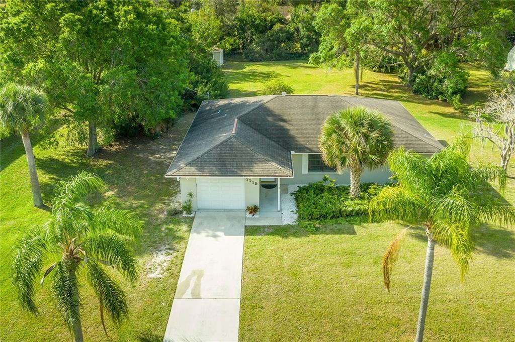 Walk to the Beach from this Beautifully RENOVATED Florida Style home - Effective year built 1994.  P