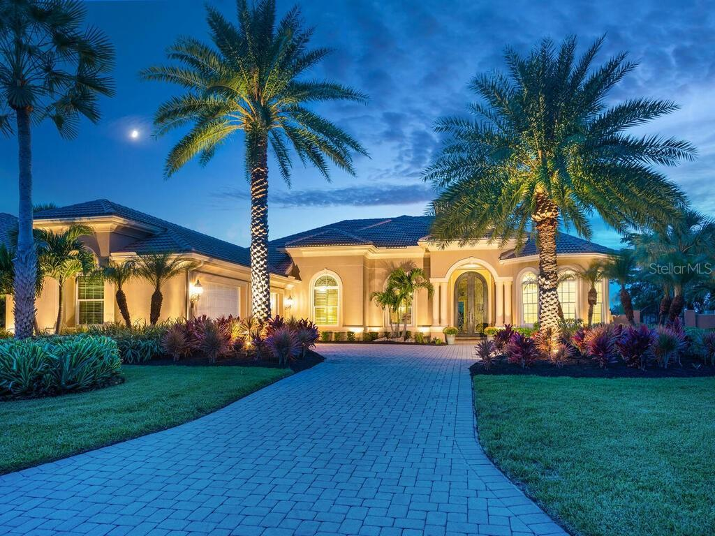 Make this gorgeous lakefront estate yours. This custom Arthur Rutenberg impresses as soon as you ent