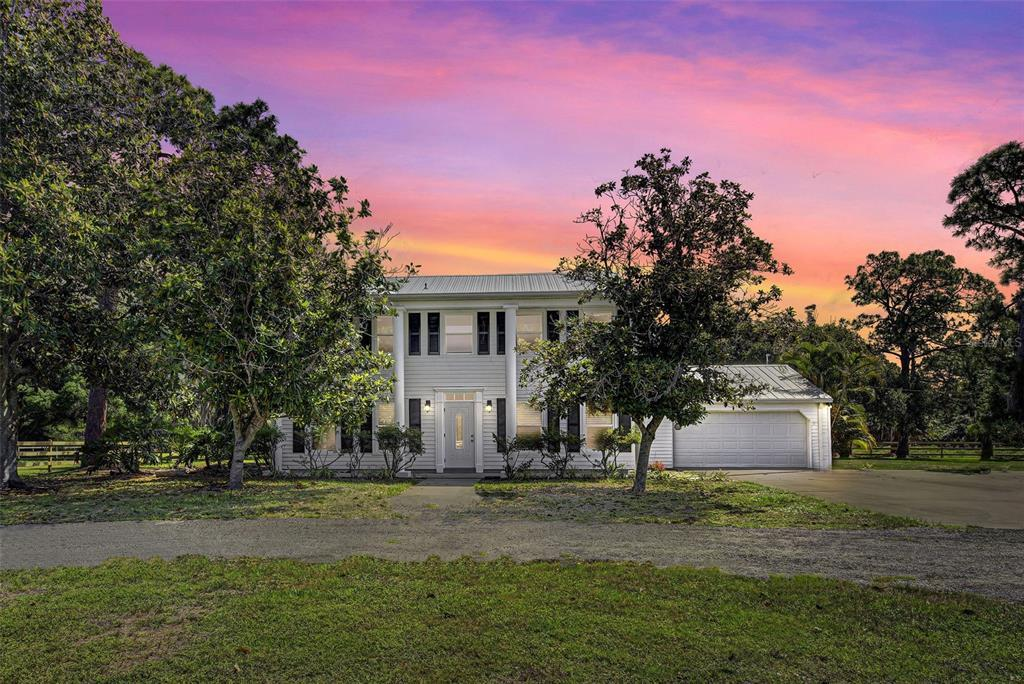 Highly desirable and rarely available... Estate size home situated on 4 Acres in north Englewood. Th