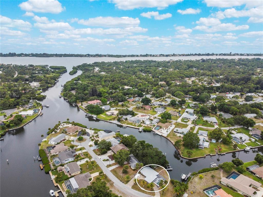 **WATERFRONT**7,500 LB BOAT LIFT**153' of SEAWALL**OVERSIZED 14,627 SF LOT**POOL/SPA PACKAGE**BEAUTI
