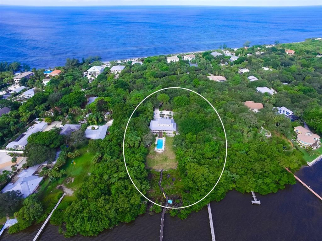 Secluded 1.24 acre tropical oasis BAYFRONT SALTWATER POOL HOME w/DEEDED BEACH ACCESS - PRIVATE - GAT