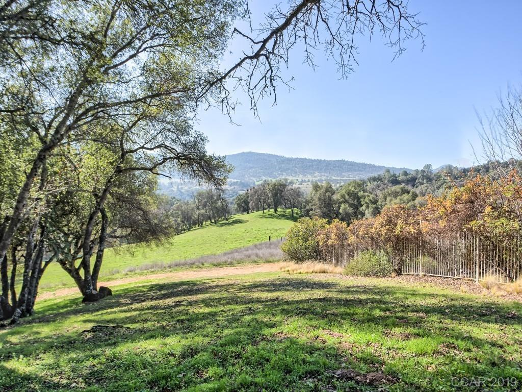 Highly desirable .45 acre lot with pastoral and Bear Mountain views! Located at the end of a quiet court in the golf course community of Greenhorn Creek (featuring a world class 18-hole golf course, two pools, spa/hot tub, tennis/pickleball/bocce ball courts, fitness center and Camps Restaurant & Bar). The perfect location to build your dream home. Included are plans for a 3350 sq ft home (4 bedroom or 3 w/Den, wine cellar, 2-car plus golf cart garage, shop, porch & deck for entertaining. CC&Rs, but No HOA! This is a relatively flat lot, so building costs will be less. Utilities are buried and at lot ready for hook-up. Close to town, wineries and fishing/boating at New Melones Lake. This lot is a must see!