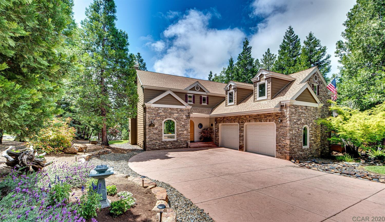 Exquisite custom built 3034 sq ft home, located on a quiet street in the gated community of Forest Meadows (one block from Clubhouse/Hilltop Park and minutes from downtown Murphys, wineries and golf). Main level includes: Dining Rm with custom beamed interior pergola, Living Rm with cathedral ceilings and dramatic stone fireplace with gas insert, Gourmet Kitchen with quartz countertops and gas cooktop & oven, walk-in Pantry, Breakfast Nook, Master Suite with jetted tub and walk-in closet, Laundry Rm/Office, 1/2 Bath, Mudroom and 600 sq ft garage. Beautifully crafted staircase to upper level which includes: Spacious Loft (optl den/game/bonus room) with deck access, two additional Master Suites and an Office (optl 4th bedroom/nursery). Features: Level .3 acre lot, level stamped concrete driveway and patio, Hardie Board siding with stone exterior accents, custom window coverings and lighting, energy efficient multi zoned heating/air with radiant heat flooring, attic whole house fan, Milgard windows, ceiling fans throughout, security system and large equipment/storage room. Community amenities include: security gate/patrols, clubhouse, two parks, pools, tennis/pickleball/bocce courts, playgrounds, dog park, trails and so much more. So many features  - see attached list for details.