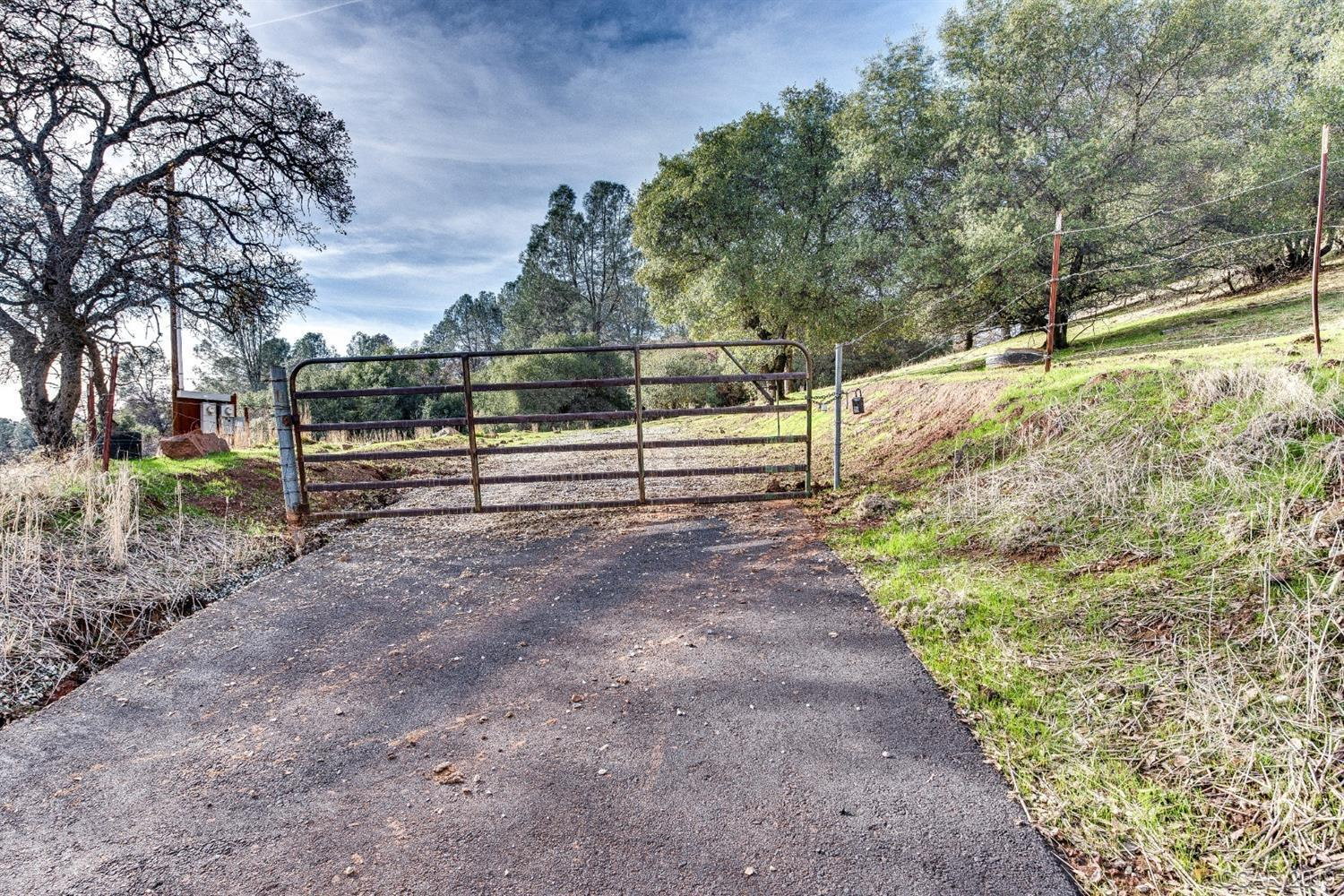Your Dream Home is waiting to be built on this spectacular property with views of the Sierra Mountains and the village below. There is a large pad at the top to build your dream home. With some tree trimming you would have a 360 view on the top.  It's near  Twisted Oak Winery, so on those summer night concerts one may hear the music.  Seller has just installed a new driveway  for easy access. The property is mostly fenced.  There are 2 electrical meters at the corner of the property by Red Hill Road. A dirt road takes you to the back of the property and to the top where the large pad is for building your dream home. The well was drilled in 2008, it produced 7 gallon per minute and electricity is to the well.  Come take a look you won't be disappointed.  Property is between Murphys and Angels Camp.