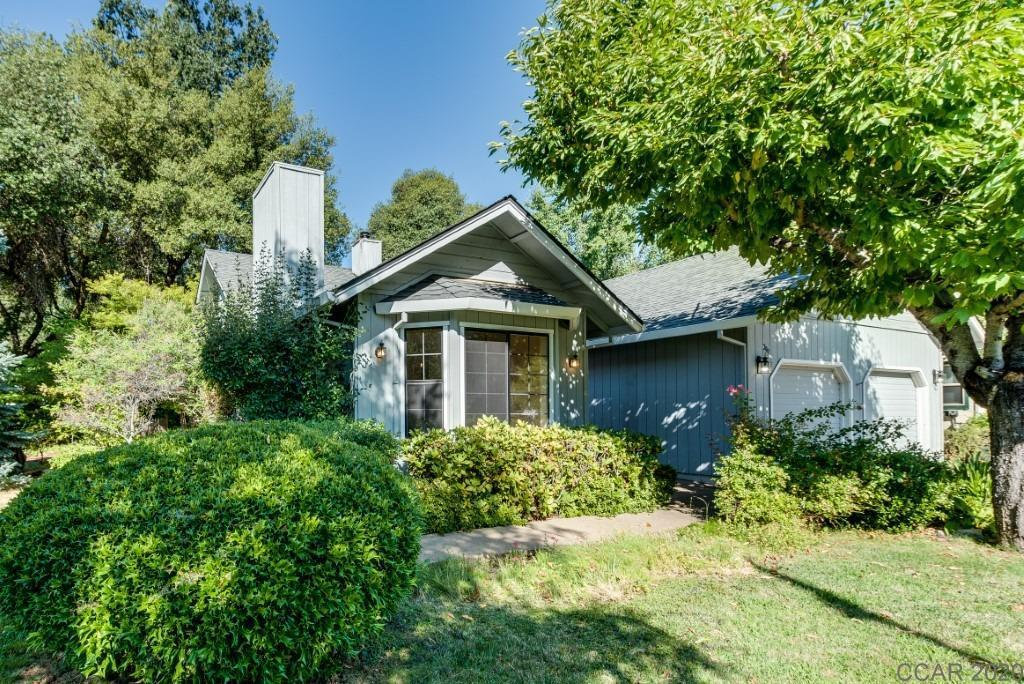 Nice Price Reduction on this home. It is in a great location and its within minutes to downtown Murphys, This is a 3 bedroom, 2 bath home on a 1/4 acre lot, This home has a large formal entry , sunken living room with a wood burning fireplace. Central Heat and Air, Central Vacuum. A Formal dining area with a built in cabinet,  The kitchen, breakfast nook and family room boost a wood burning stove for those cold winter days. Off of the family room you have sliders that take you Patio and backyard. There is a side yard with a cement pad for your R.V. Plus an attached 2 car garage off of the Laundry Room.  There is lots of room for all all of your toys.  The 2 garage has a  work bench and cabinets, and attic storage with pull down stairs, In the last year Seller has replaced the roof, and put gutter guards on the gutters.  Seller also has replaced the furnace in 2019. Painted the inside. This home has so much to offer.  Come take a look.