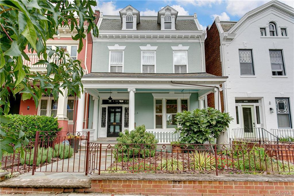 It is a rare opporttunity to find a detached Fan row house with a large front porch and off-street p