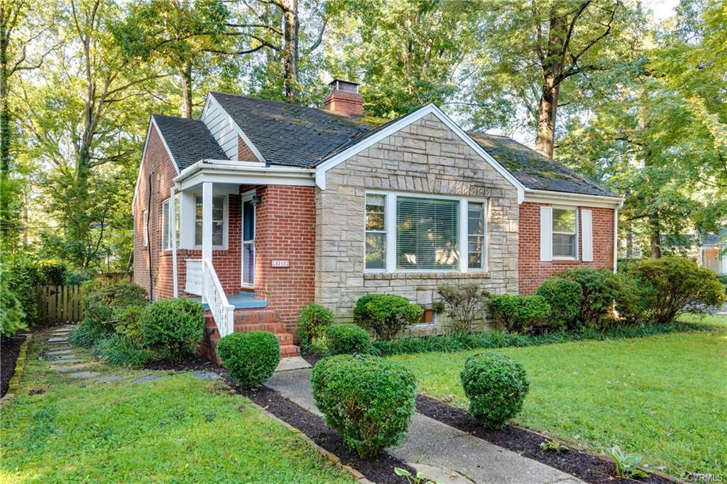 This charming Westover Hills cottage sits on a large corner lot and provides beautiful living space