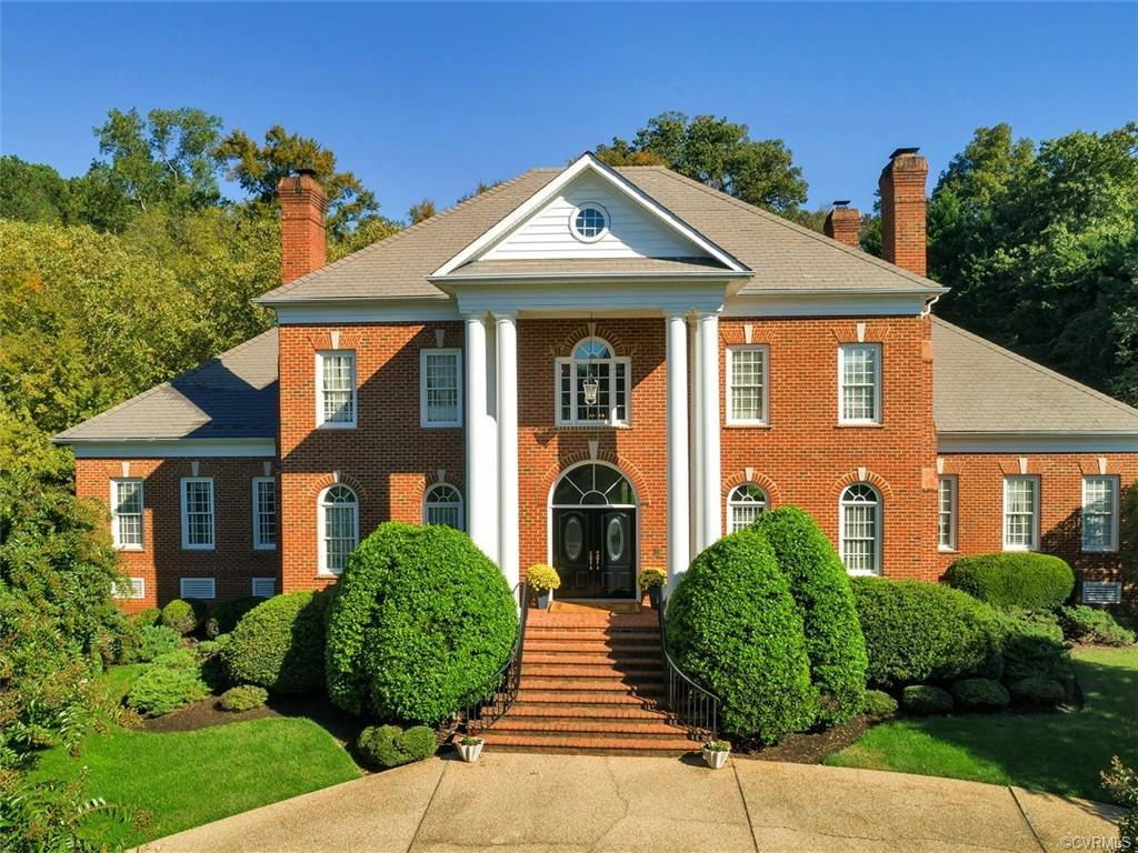 Welcome to this timeless Custom Brick Georgian Colonial tucked back in the exclusive Mooreland Landi