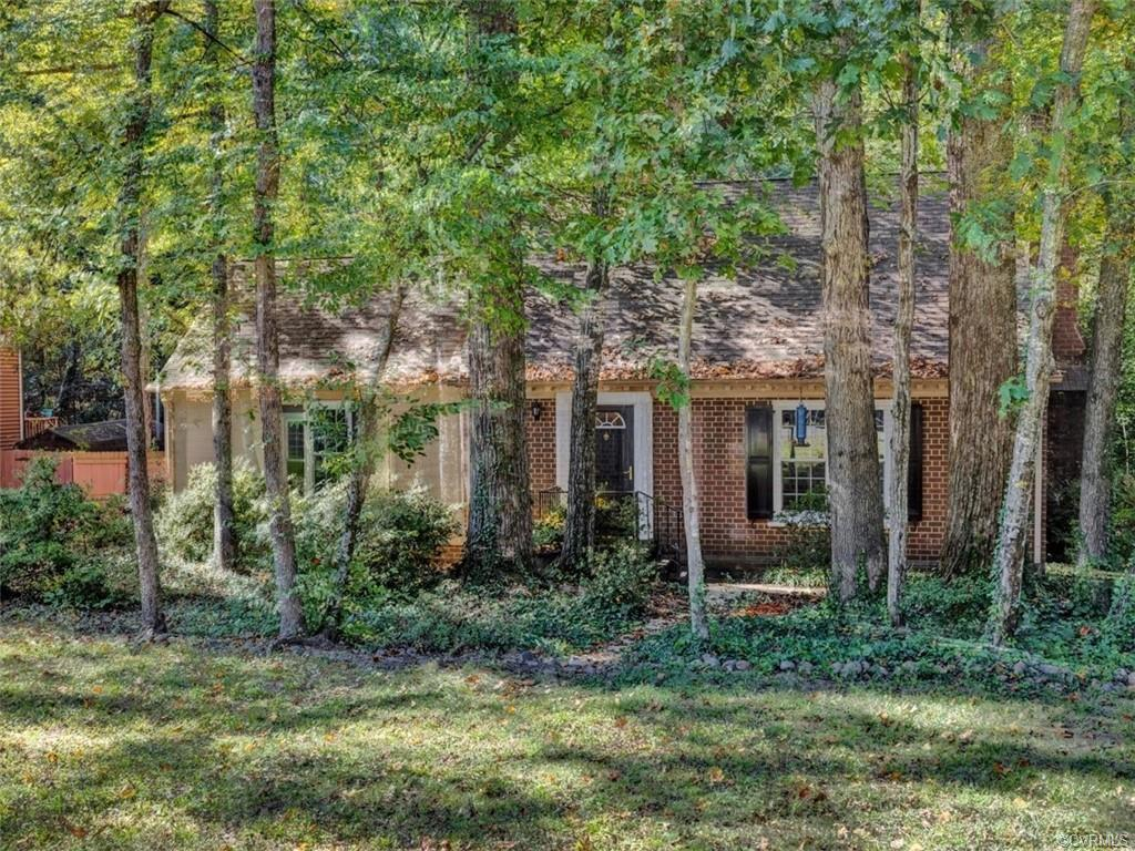 Adorable STORY AND A HALF cape with 3 bedrooms, 2.5 bathrooms on almost HALF ACRE private lot in Wes