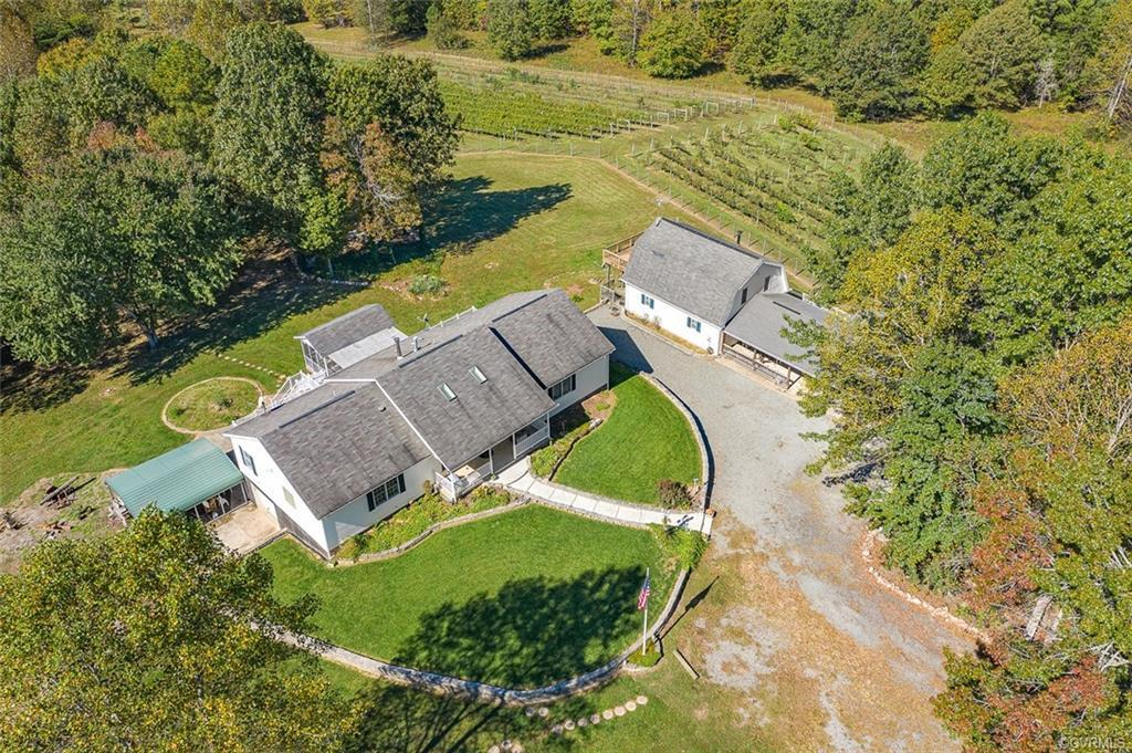 Beautiful Vineyard and  farm in Goochland Virginia, This turnkey ranch style Home on 89 acres offers