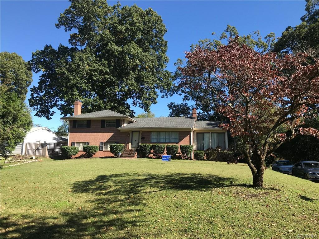 Brick tri-level home, fireplace, enclosed porch, Hardwood floors, new central air conditioning (inst