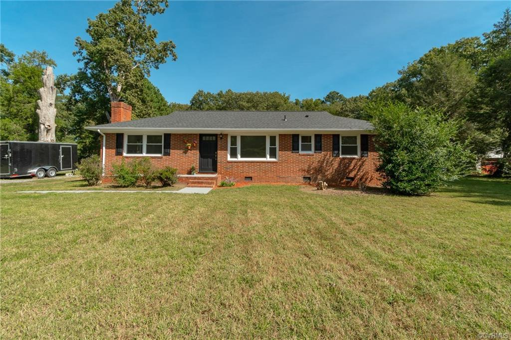 Welcome to 8221 Buffin Rd - beautifully renovated home in Varina! Enter the family room with high en