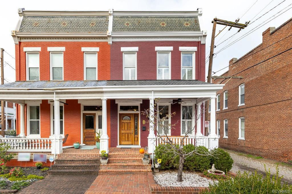 This attractive, fully renovated house offers a full front porch overlooking charming side street.