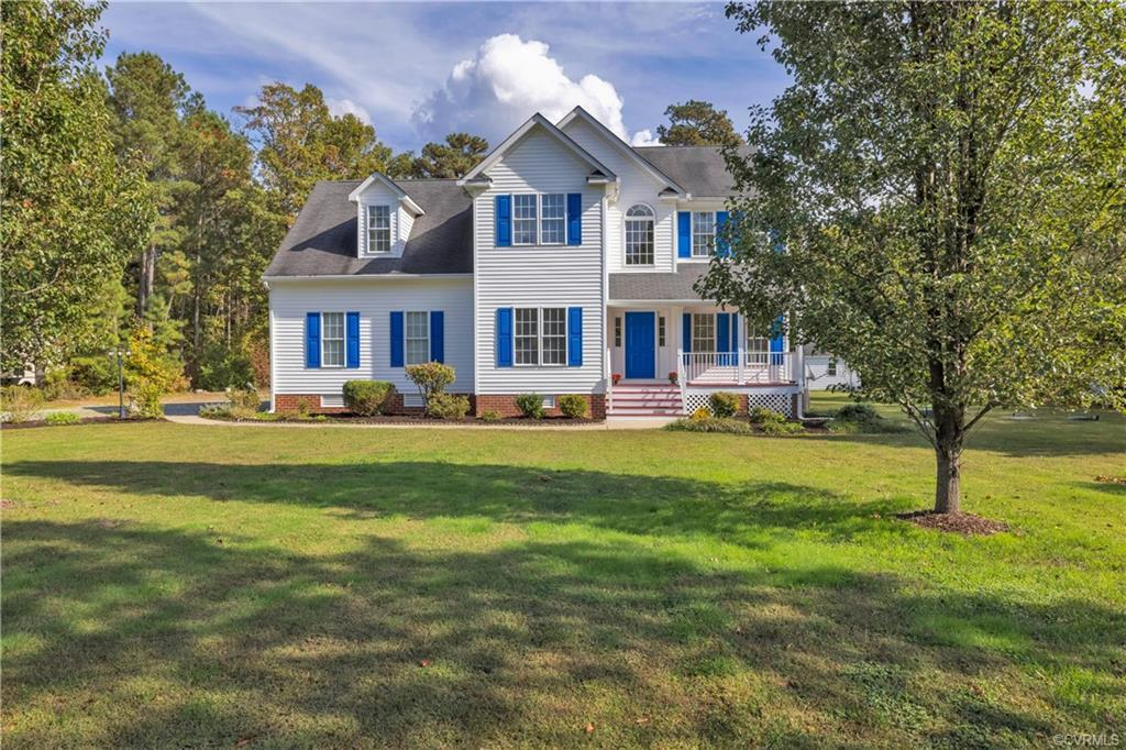 Absolutely pristine 4-bedroom home on a one-acre lot. This gorgeous home features a bright 2-story f