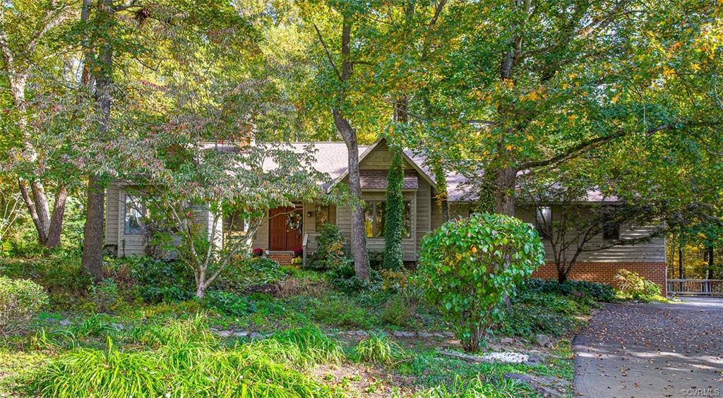 EXECUTIVE-STYLE, CUSTOM RANCH ON LARGE WOODED LOT. Feels like a private vacation home with the ultra
